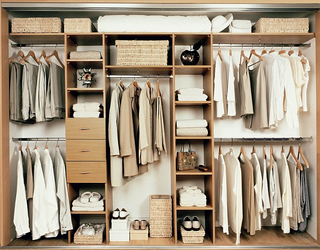 Clothes hanging inside wardrobe
